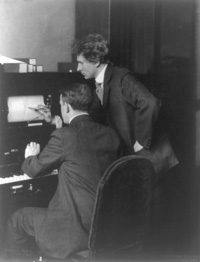 Composer Percy Grainger corrects a Duart piano roll recording.