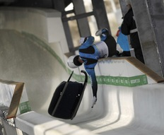 Georgian luge hopeful Nodar Kumaritashvili crashes during the men's Luge practise at the Whistler Sliding Center;AFP