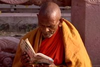 Monk reads prayer book