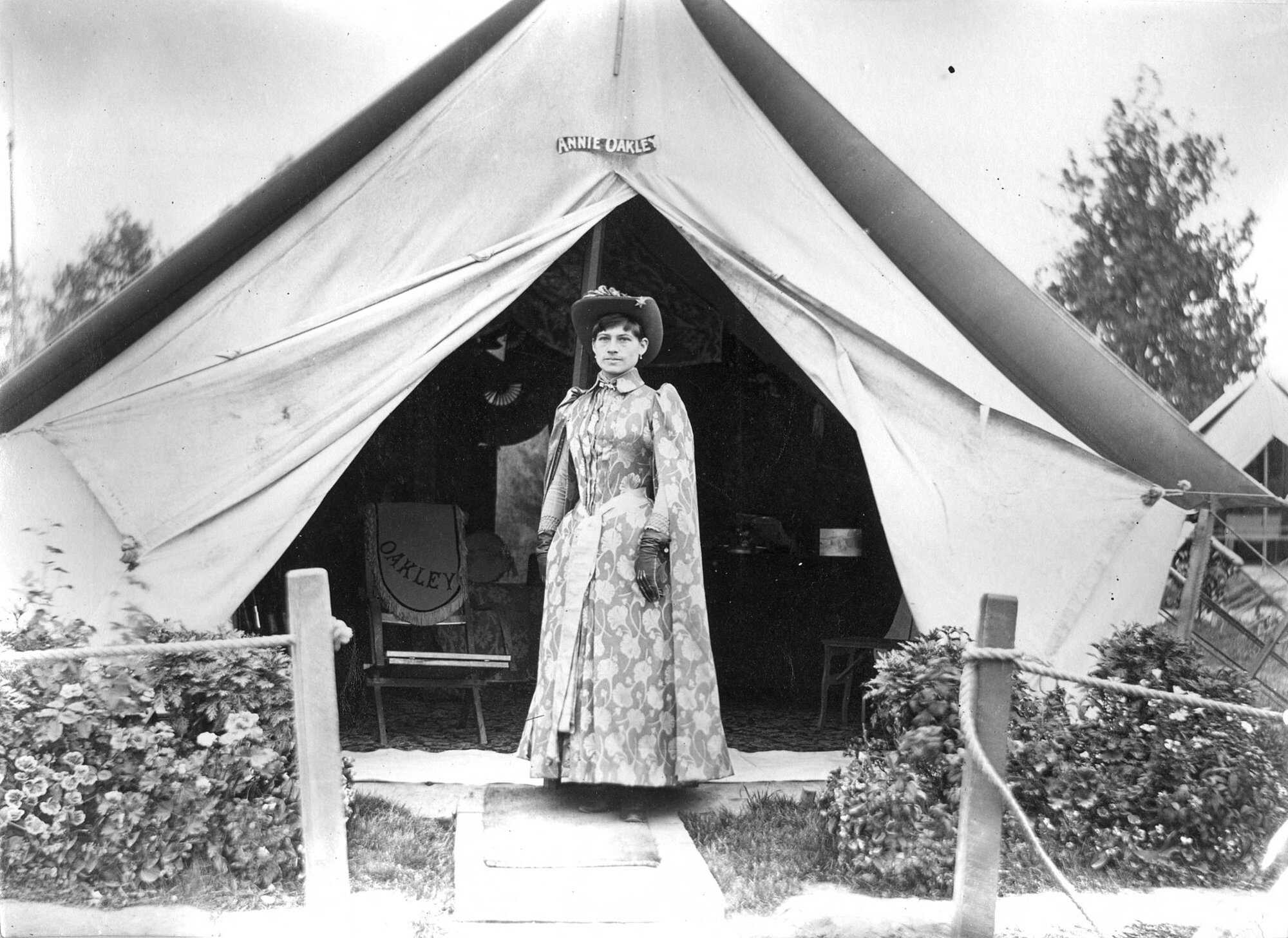 Oakley_Biography_Feature_in_front_of_tent_c1889 Infron to fher tent in Europe.jpg