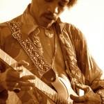 Jimi Hendrix in sepia glow, rehearsing in backyard in Beverly Hills