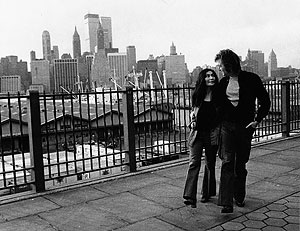 John and Yoko walking with the NYC skyline. ©Ben Ross