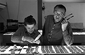 "Ray and Charles Eames selecting slides for the exhibition, ""Photography & the City, 1968."" © 2011 Eames Office, LLC."