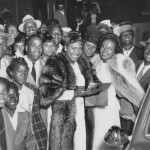 Sister Rosetta Tharpe (in fur coat) and Marie Knight (on the right with a fur stole) with fans after a concert in St Louis on 3 June 1947. Photo Credit: Photo by Karl's Photo of St Louis from the collection of Mrs Annie Morrison.