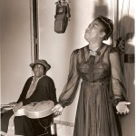 Sister Rosetta Tharpe recording at Decca Records with her mother Katie Bell holding her guitar in 1941. Photo Credit: Photo taken by Charles Peterson. Courtesy Don Peterson.