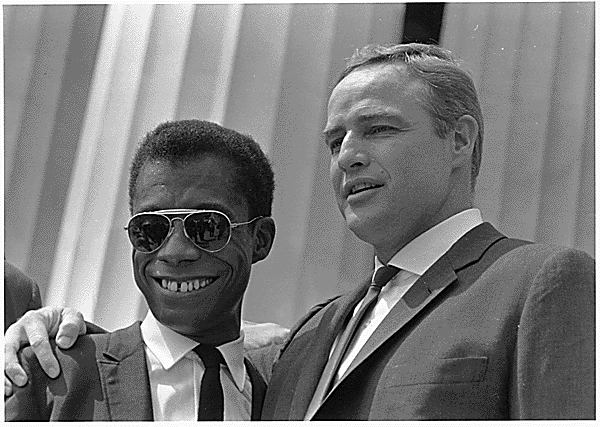 James Baldwin and Marlon Brando at Civil Rights March in Washington, D.C., 08/28/1963.U.S. Information Agency. Press and Publications Service.