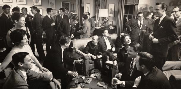 "George Plimpton (bottow left) and Truman Capote (sitting far left on couch) at a cocktail party in Plimpton's apartment, as seen in ""American Masters: Plimpton! Starring George Plimpton as Himself."" Photo: Cornell Capa/Laemmle Zeller Films"
