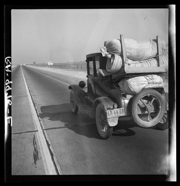 Drought refugee's car on U.S. Highway 99 between Bakersfield and Famoso, California. Note: the photographer passed 28 cars of this type (drought refugees) between Bakersfield and Famoso, 35 miles, between 9 and 9:45 in the morning. November 1936. Photo: Dorothea Lange