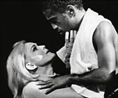Sammy Davis, Jr. as prize-fighter Joe Wellington with Paula Wayne, playing Lorna Moon.