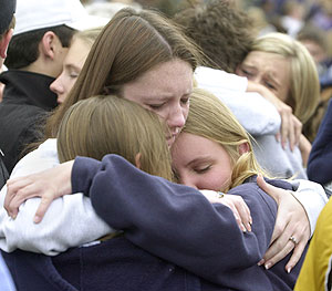Students embrace after a memorial service