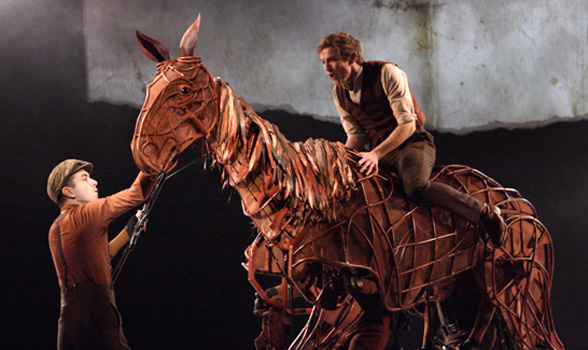 JACK HOLDEN as Albert in War Horse, with TOBY OLIÈ, THOMAS WILTON and MICHAEL BRETT as Joey, in 50 Years on Stage. Photo by Catherine Ashmore.