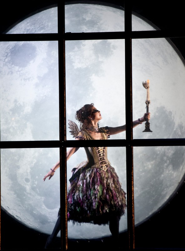 A fairy visits baby Aurora in Matthew Bourne's Sleeping Beauty. Photo by Simon Annand.