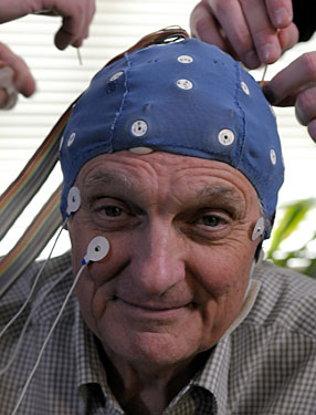 Alan Alda models the EEG cap