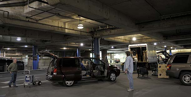 Unloading all the gear from our three vehicles. Credit: Larry Engel