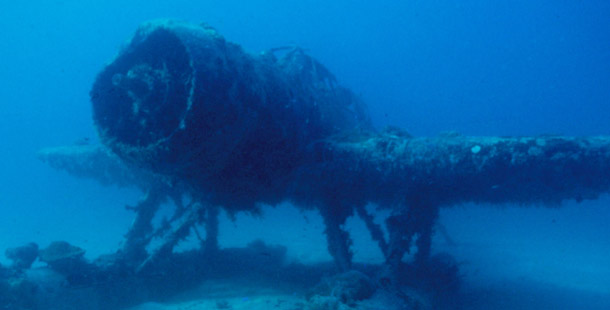 Thousands of tons of war wreckage sank into the fabled lagoons of the