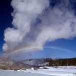 Rainbow over a geyser