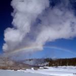 Rainbow over a geyser
