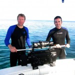 Underwater Cinematographer Shane Moore and Producer Doug Shultz load the camera onto the dive deck. Cayo Levisa, Cuba (Photo by David Guggenheim).