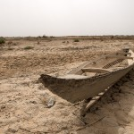 Saddam Hussein had the Mesopotamian Marshes drained, leaving only desert and remnants of the past, like this abandoned Marsh Arab boat.