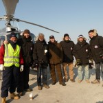"""The team prepares to take flight over the Russian forest in a helicopter. We needed a bird"