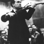 Bronislaw Huberman standing, with violin. Courtesy of the Murray S. Katz Photo Archives of the Israel Philharmonic Orchestra.