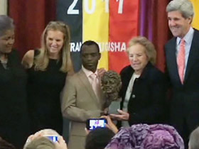 Frank Mugisha receives an award from the Robert F. Kennedy Center for Justice and Human Rights