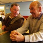 (From left) Retired employees Chuck O'Connell, 66, and James Collins, 73, reminisce during the sit-in. O