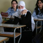 Druze women have always had the right to own and sell property, and most are literate and educated. In the photo above, two Druze students wear regular school uniforms, while the third wears the white veil traditionally worn by initiated Druze women. A woman
