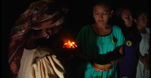 Young Wayuu women by the campfire.