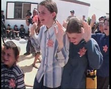 Children crying during evacuation.