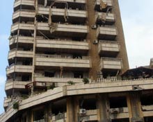Damaged apartment building following Israeli air attacks.