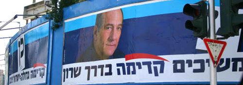Kadmia's slogan- a picture of Ehud Olmert with the words continuing forwards in Sharon's way