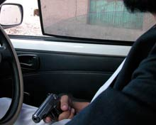 Afghan driver with gun on his lap.