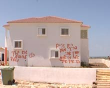 House marked with graffiti.