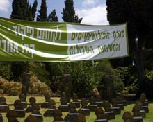 Protest banner hangs in cemetery.
