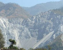 A huge landslide carves out the mountainside.