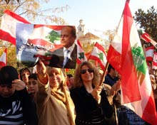 Protestors wave flags in mass protests in Beirut.