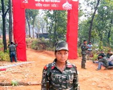 Female Maoist soldier outside camp.