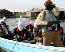 Armed militants on a patrol boat in the Niger Delta.
