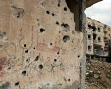 Buildings marked by shell fire attacks.