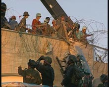Settlers create barriers of barbed wire.