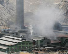 Smelter plant shrouded in gas emmissions.
