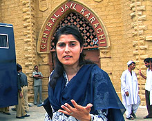 Reporter Sharmeen Obaid in front of prison gates.