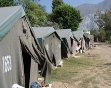 Rows of tents serve as makeshift shelter.