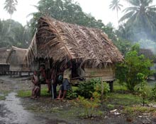 Villagers shelter from rain.