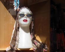 headscarves in shop window.