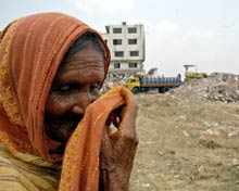 Woman at the site of the collapsed building.