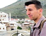 Young  Bosnian man interviewed overlooking the city.