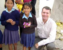John Wood with two school girls.