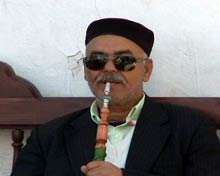 Libyan man smoking water pipe.